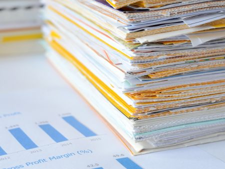 Stack of documents at business office,financial reports and statements,high key tone.