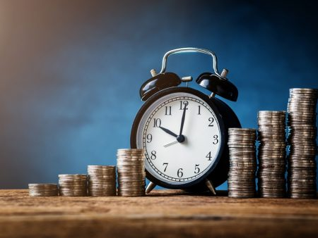 business financial ideas concept with coins stack and alarmclock isolate background with free copyspace for your creativity ideas text